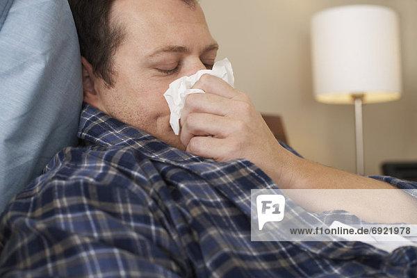 Mann  Krankheit  Bett