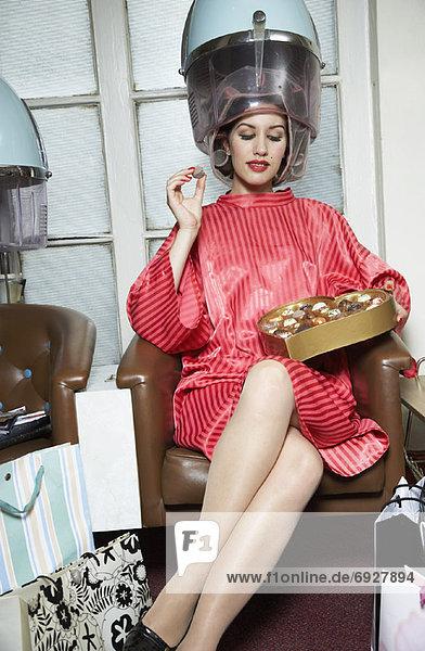 Woman at Hair Salon  Eating Chocolates Woman at Hair Salon, Eating Chocolates