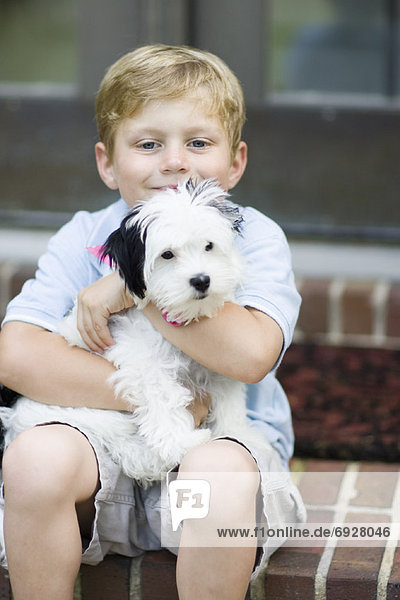 Portrait of Boy Holding Dog