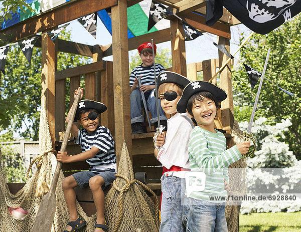 Portrait of Boys Pretending to be Pirates