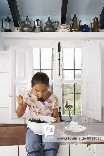 Girl with Mixing Bowl of Chocolate