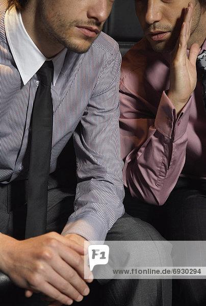 Businessmen Sharing Secret