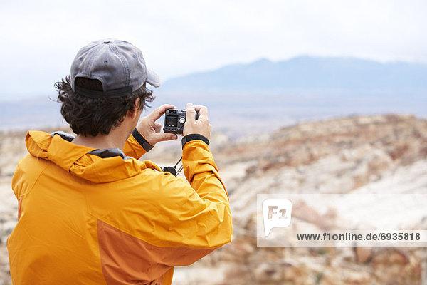 Man Taking Picture  Capital Reef National Park  Utah  USA