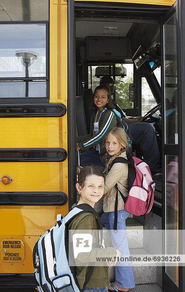 Children Boarding School Bus
