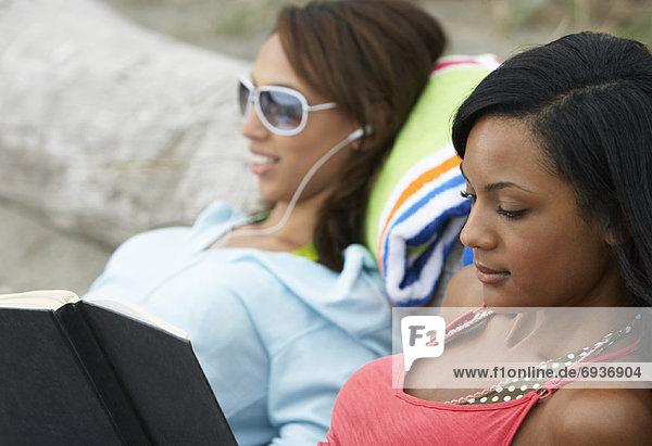 Women Relaxing at Beach