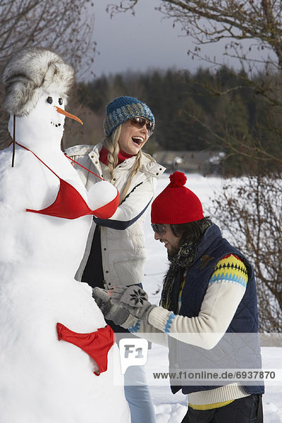 Couple Building a Snow-Woman  Meadow Park  Whistler  British Columbia  Canada