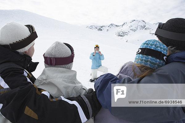 People Having Photo Taken on Ski Hill  Whistler  BC  Canada
