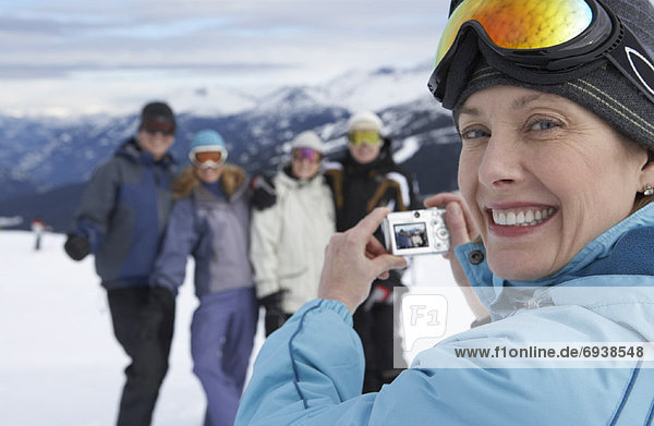 Woman Taking Picture on Ski Hill  Whistler  BC  Canada