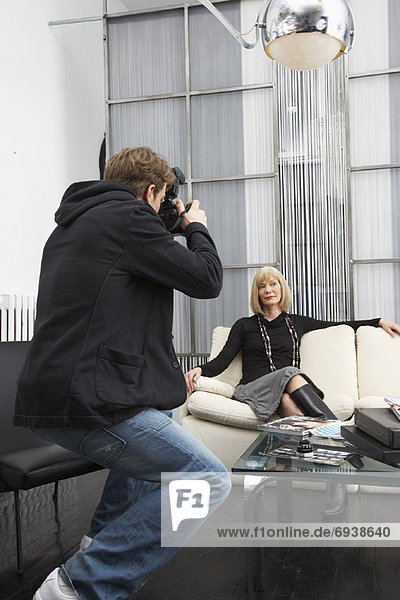 Photographer Taking Picture of Businesswoman