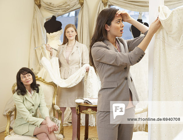 Woman in Bridal Boutique Looking at Price Tag