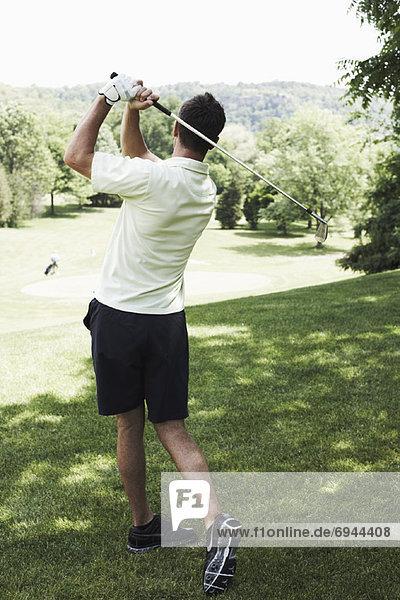 Mann Golfen