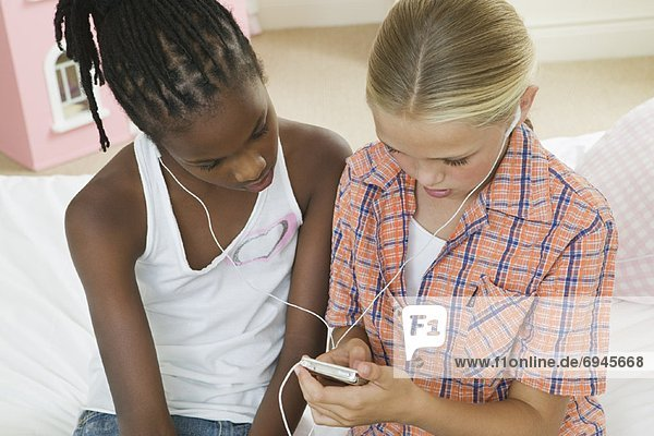 Girls Listening to MP3 Player