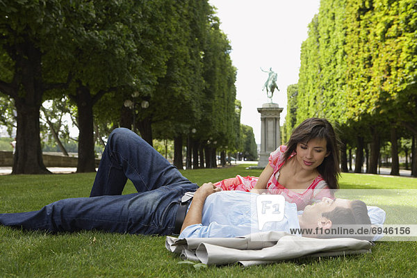 Couple Lying Down at Park