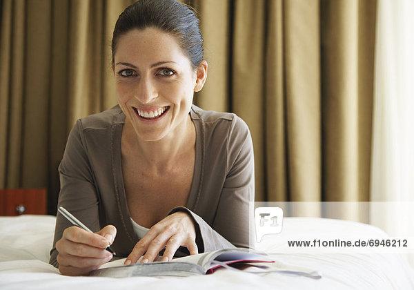 Frau Writing in Journal