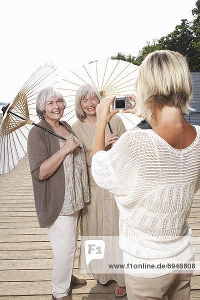 Women Posing for Picture on Boardwalk