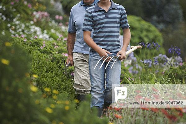 Grandfather and Grandson Gardening