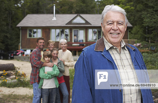 Portrait of Extended Family by Cottage