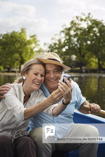 Couple in Rowboat  Taking Photo of Themselves