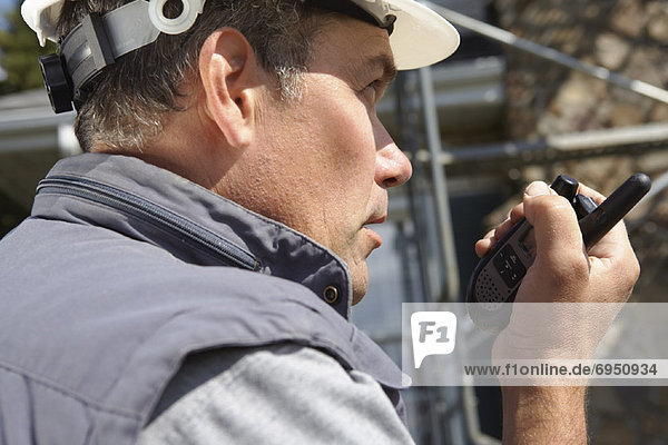 Construction Worker with Cellular Phone