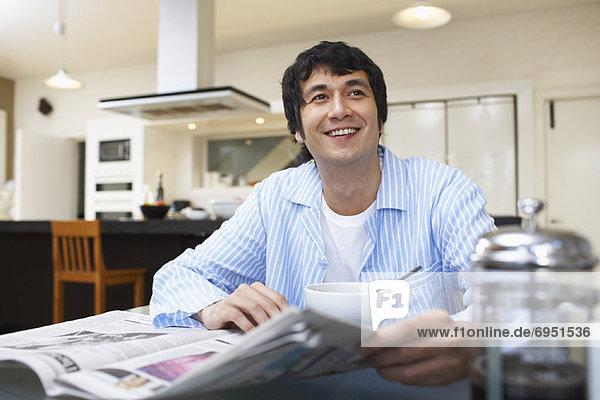 Man Eating Breakfast  Reading Newspaper