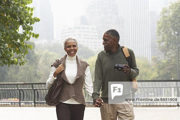 Couple Walking in City  New York City  New York  USA