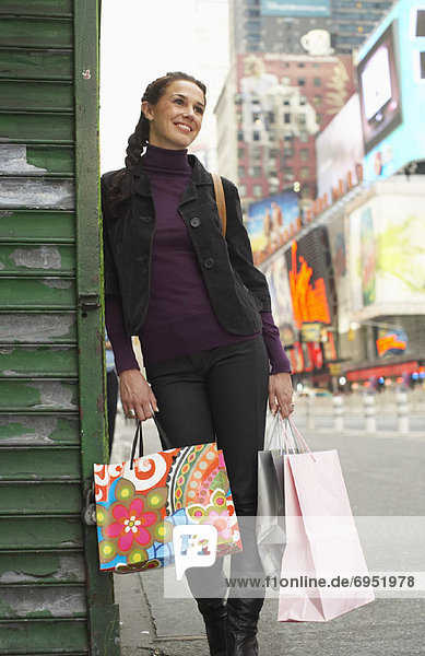 Woman in City with Shopping Bags  New York City  New York  USA