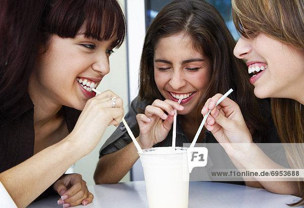 Girls Sharing Milkshake