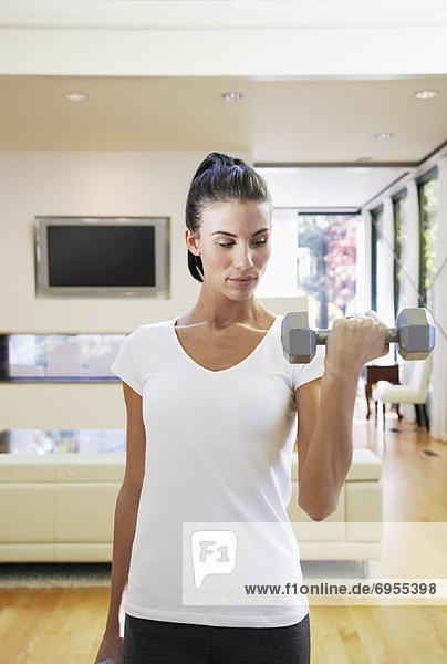 Woman Exercising in Home