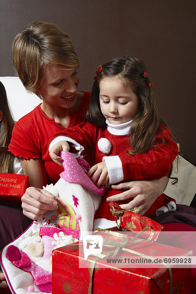 Mother and Daughter Opening Christmas Stocking