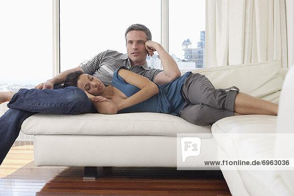 Couple on Sofa in Condominium