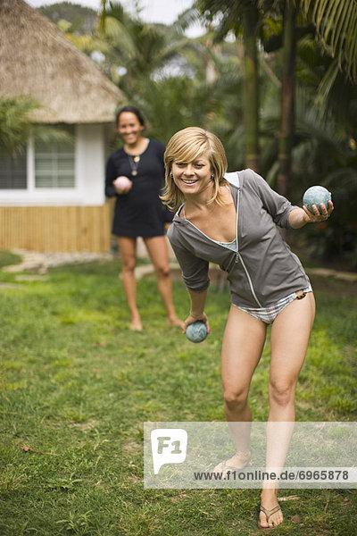 Women Playing Bocce Ball in Yard