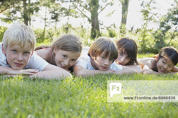 Group Portrait of Kids Lying Down Outdoors  Elmvale  Ontario  Canada