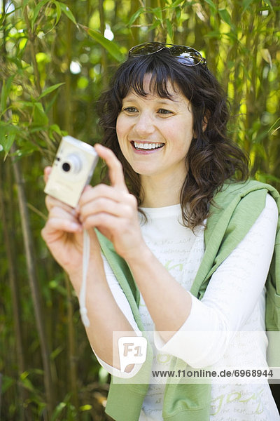 Woman Taking Pictures  San Francisco  California  USA