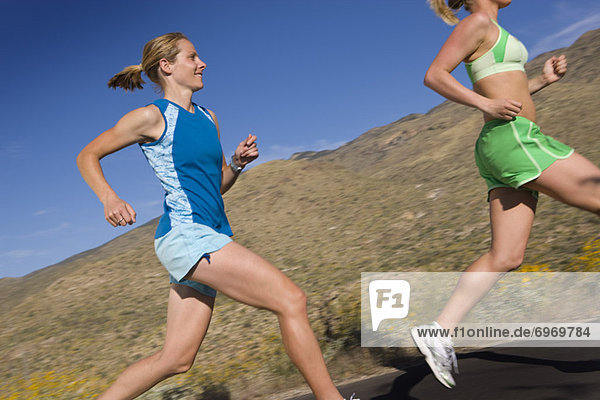 Woman Running on Paved Road  Saguaro National Park  Tucson  Arizona USA