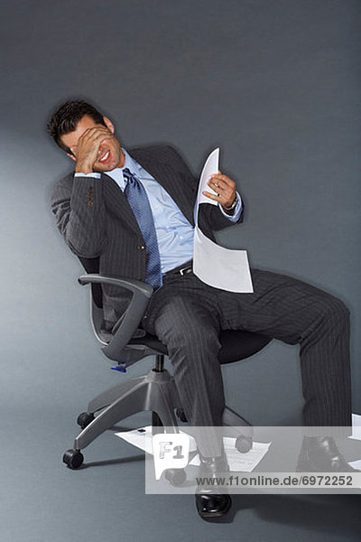 Frustrated Businessman Holding Documents