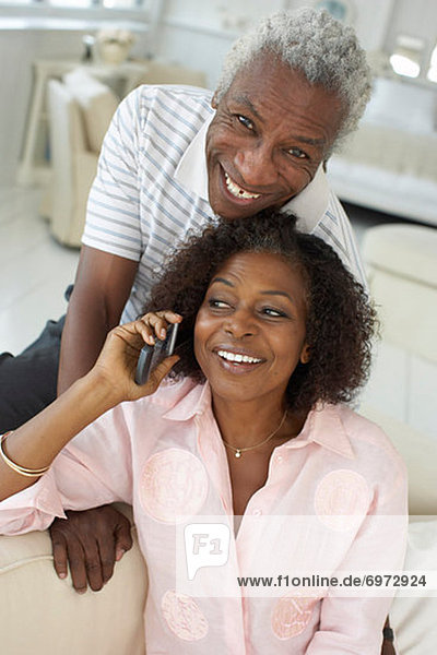 Portrait of Couple  Woman Talking on Cellular Phone