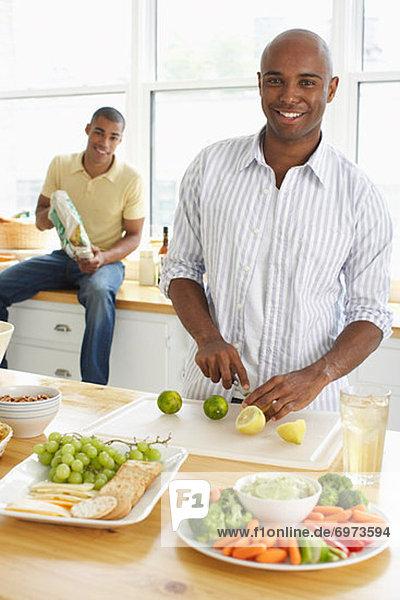 Men making snacks for guests