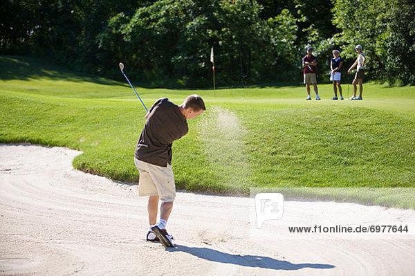 Mann  Sand  Falle  Fallen  Golfsport  Golf  Rückansicht  Kurs
