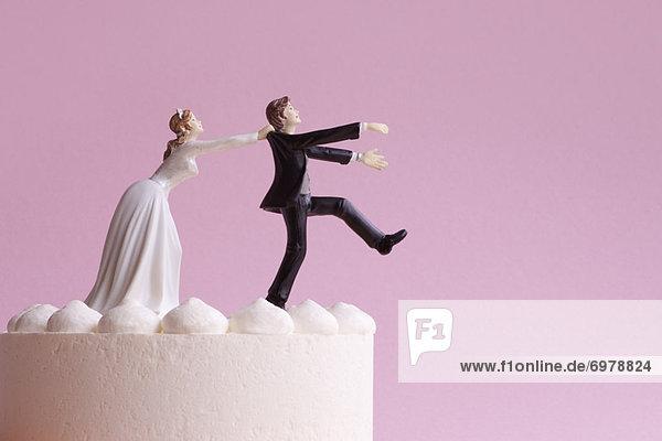 Wedding Cake Figurines  Bride Grabbing Runaway Groom