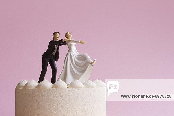 Wedding Cake Figurines  Groom Grabbing Runaway Bride