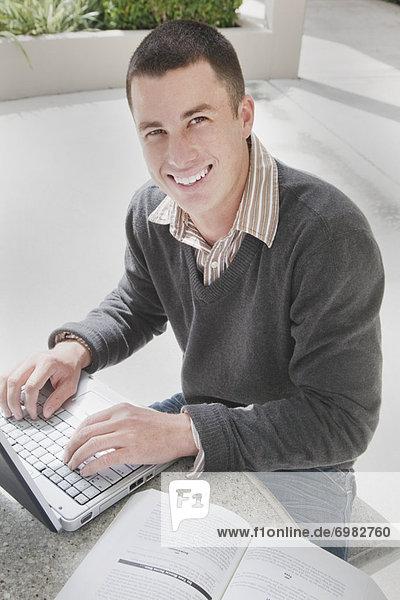 University Student Using Laptop Computer