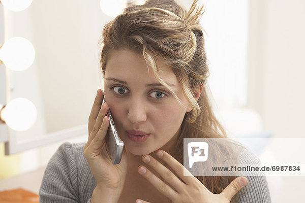 Close-up of Woman Talking on Cell Phone