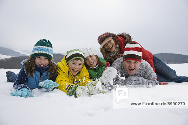 Portrait of Family Playing in Snow
