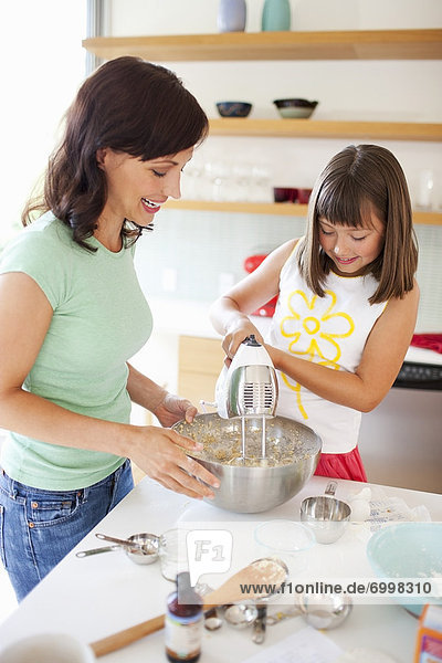 Mother and Daughter Baking Cookies  Portland  Oregon  USA