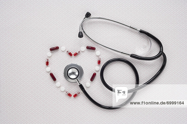 Pills in Heart Shape with Stethoscope