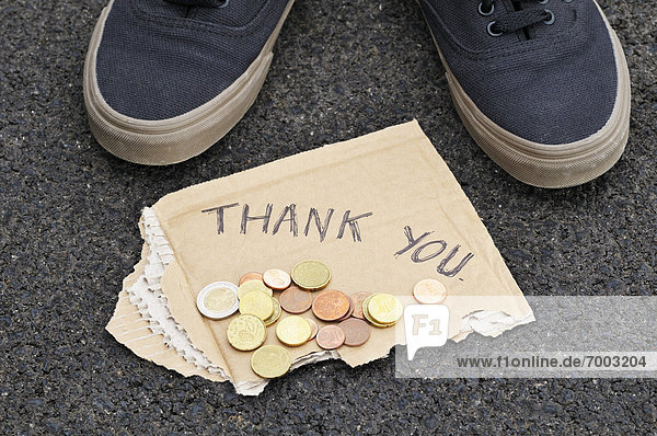 Feet with Spare Change and Thank You Sign