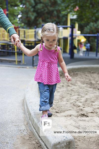 Girl Holding Moms Hand  Washington Park Playground  Portland  Oregon  USA
