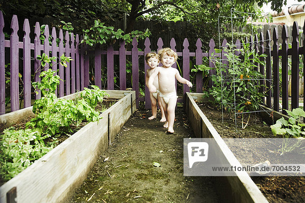 Twin Boys Playing in Garden