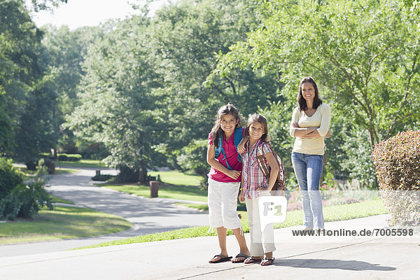 Mother and Daughters Walking Home from School