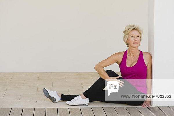 Mature woman doing spinal twist
